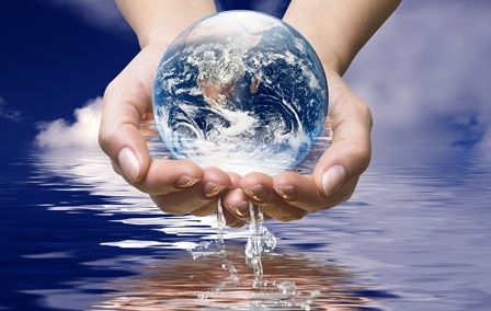 Earth in 2 hands over water
